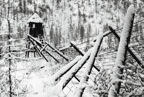 View of the snow-covered barbed wire fence and guard tower at a disused Stalinist convict camp, Siberia, Russia, 1989. (Photo by Igor Mikhalev/FPG/Getty Images)