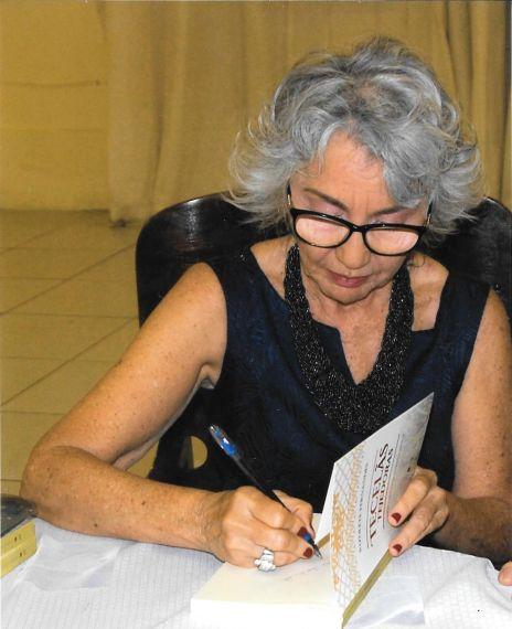 1 Rizolete Fernandes, firmando ejemplares durante la presentación brasileña